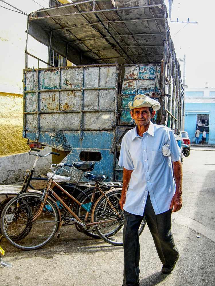 Cuban street scene -  Lorry and bike