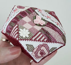 rose biscornu pincushion designed by Cherry Parker