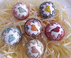 Birds of a Feather cross stitch designs on foam balls