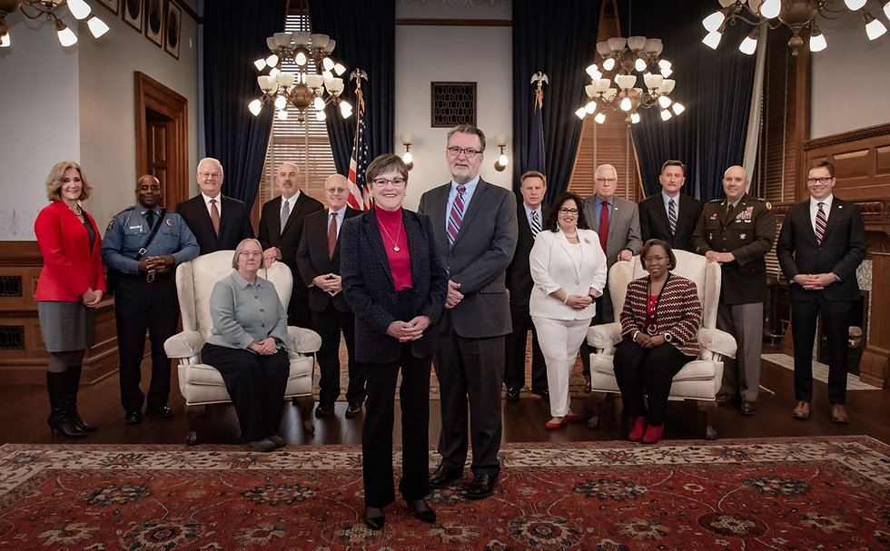 Governor Laura Kelly, standing with her cabinet