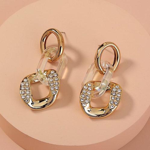 Boucles d'oreilles avec mélange de transparence, strass et alliage doré