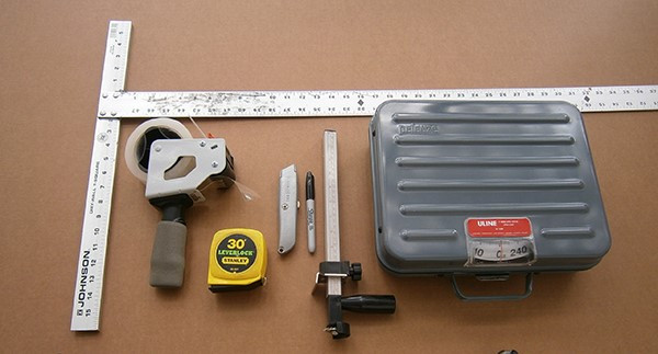 Shipping Tools | From left: T-Square, Tape Gun, Tape Measure, Knife (Box Cutter), Sharpie, Box Sizer, Shipping Scale