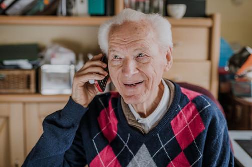 Happy old man making call resize.jpg