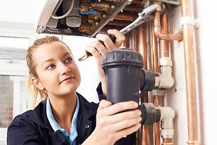 Lady plumber fixing boiler (resized).jpg