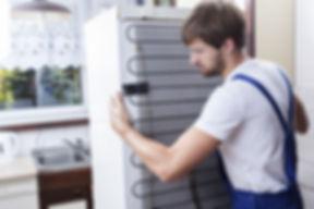 Dude in overalls moving fridge.jpg