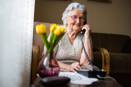 Happy old lady on the phone.jpg