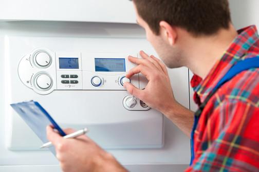 Plumber servicing boiler.jpg