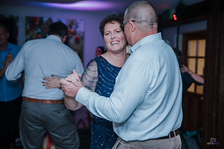 Old married couple dancing at a party