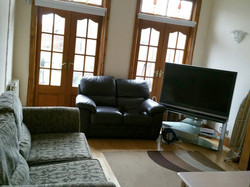 Lounge with sofa's and TV