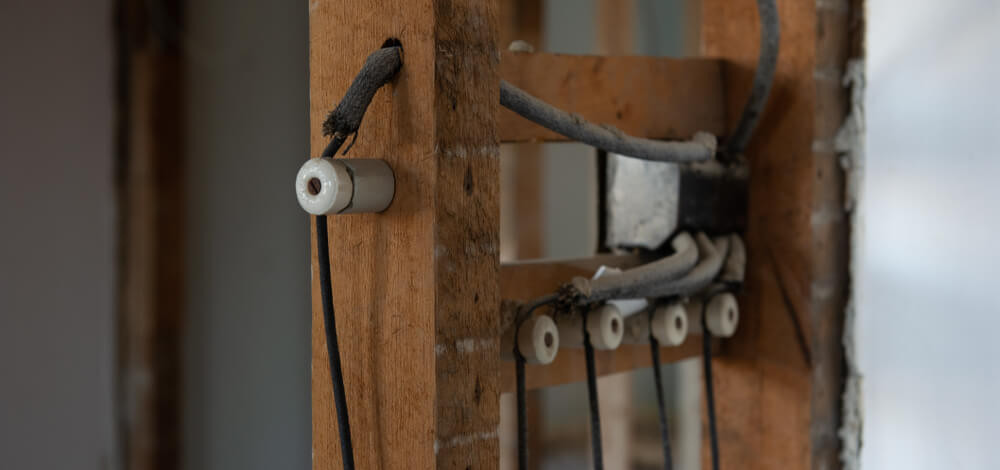 Knob and tube wiring in an old home, in need of replacement by a good electrician.