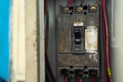 A very old electrical breaker on an electrical panel that should be replaced by an electrician..