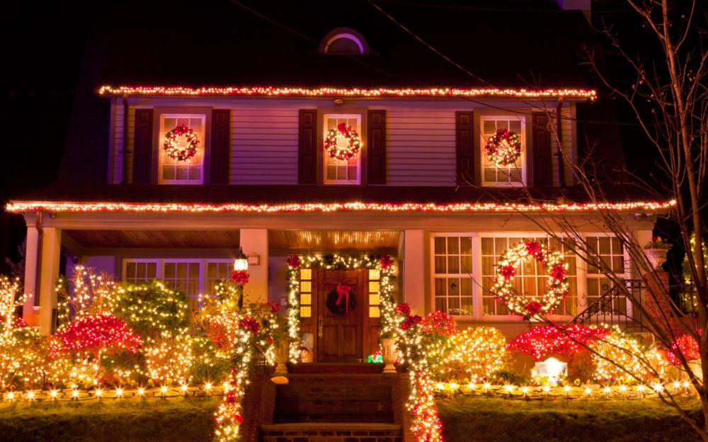 House with a lavish Christmas light display, the type that might need an extra electrical circuit installed.