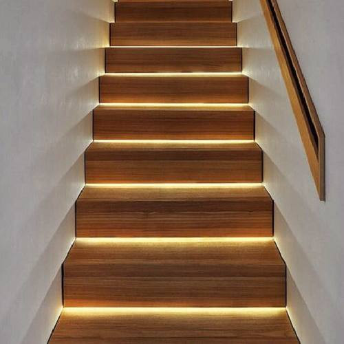 Stairs with LED strip lighting at each step: a great idea to install with the help of your electrician.