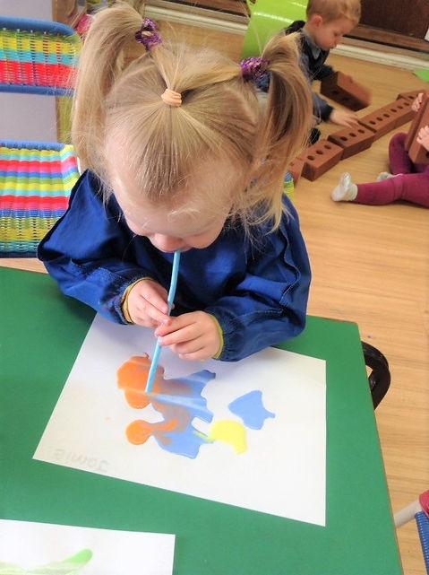 toddler paint blowing.jpg