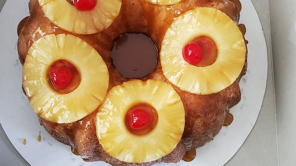 Double Pineapple upside down bundt cake topped with caramel drizzle