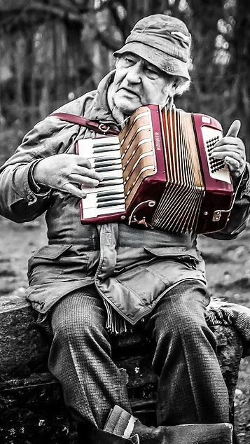 Man-play-accordion-music-box-retro-style
