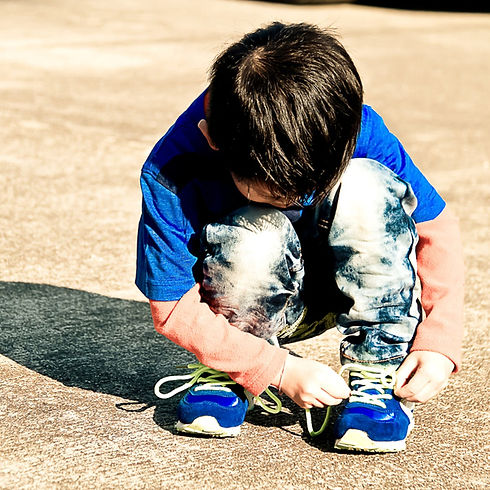 boy tying shoes.jpg