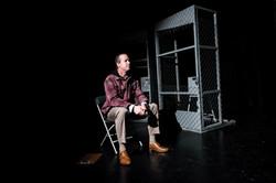 Joe in front of cage - Deechen scene