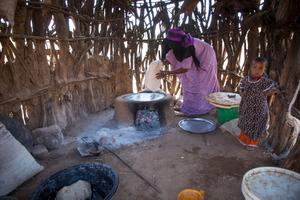 Ethiopian woman baking bread.  Dignity Period.