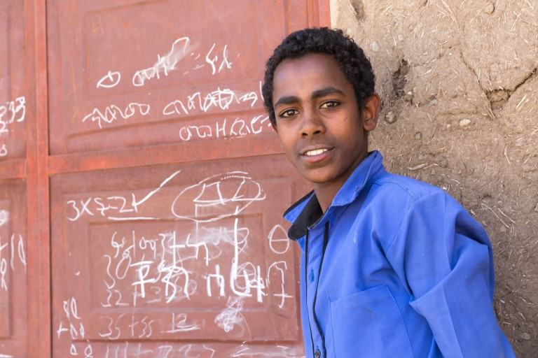 male ethiopian student learning about menstruation
