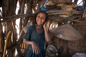 Etihopian girl in kitchen. Dignity period.