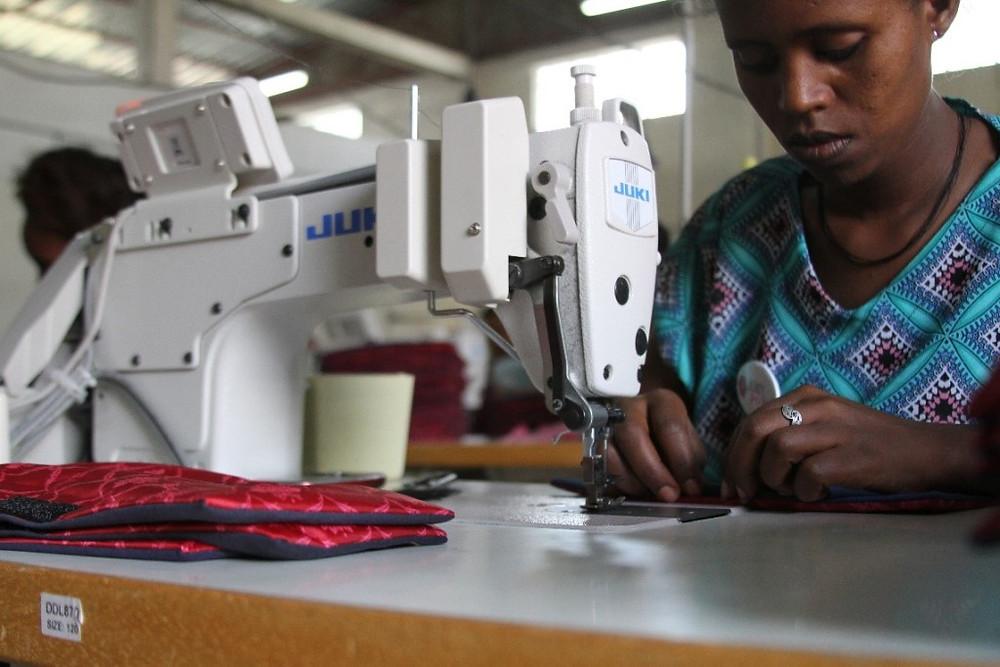 ethiopian woman sewing reusable sanitary pad