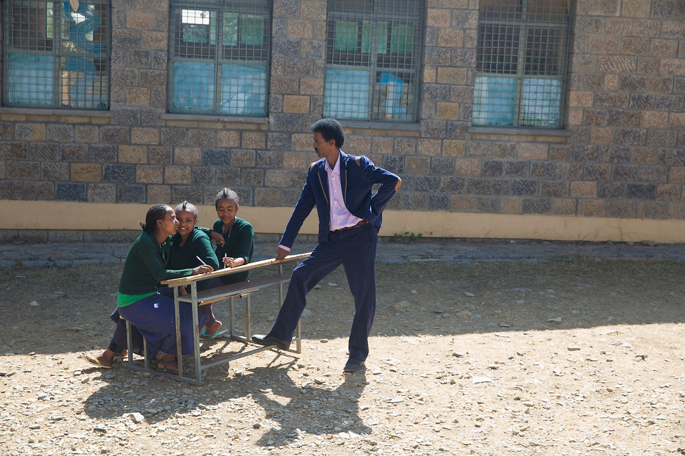 Shewaye Belay, dignity period project manager, talking with ethiopian girls