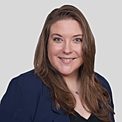 Shannon Hybner Headshot Gray Background.