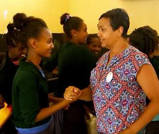 Freweini Mebrahtu dancing with young woman