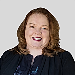 Janet Hanna headshot Gray Background.jpg