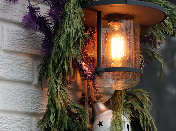 Outside lamp with purple wreath