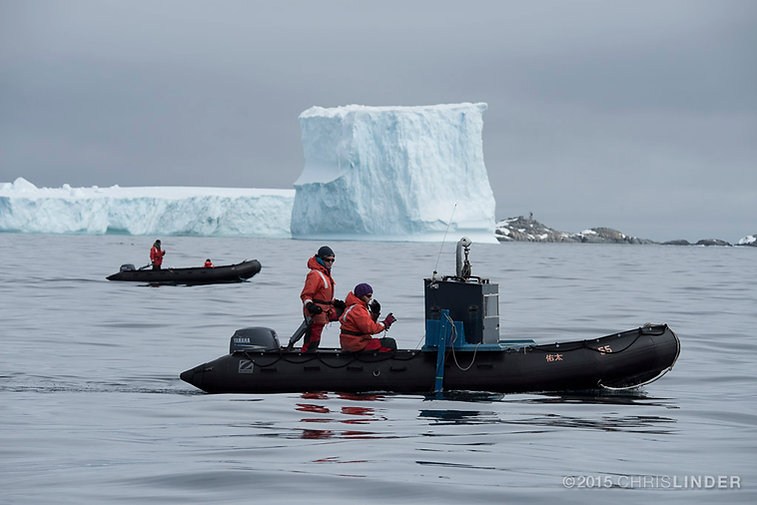 Bernard and Raycroft mapping Antarctic krill from a Mach V Zodiac near Palmer Station, Antarctica