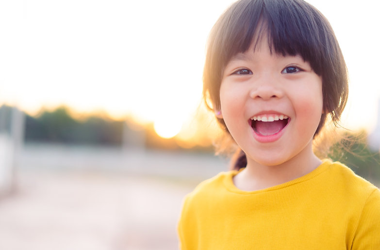 Happy Little asian girl child showing front teeth with big smile and laughing_ Healthy hap