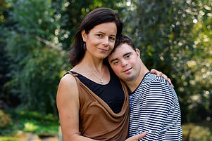 portrait-of-down-syndrome-adult-man-with-mother-st-2021-04-06-18-30-58-utc.jpg