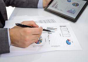 businessman-reviewing-documents-in-digital-tablet-2021-07-23-23-24-07-utc.jpg