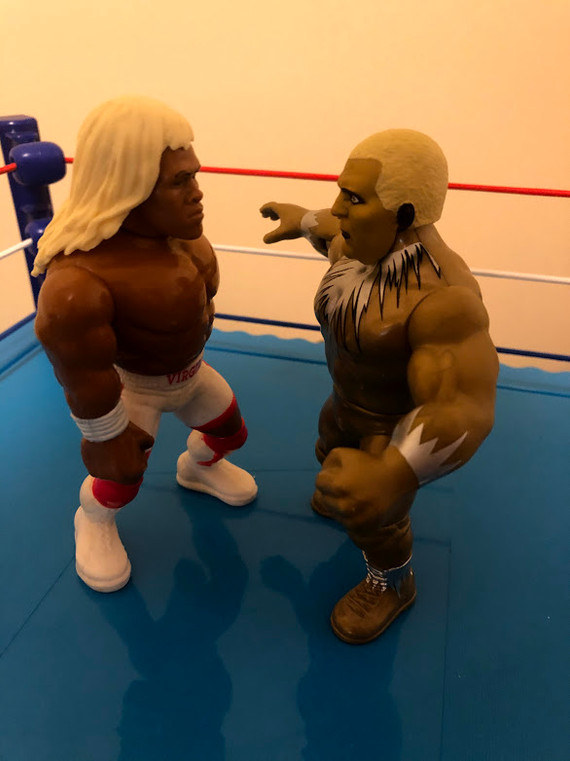 Virgil has pulled off Goldust's wig! That has to be the first time that's ever happened in the history of The Retro Rumble! Or The Royal Rumble, for that matter.