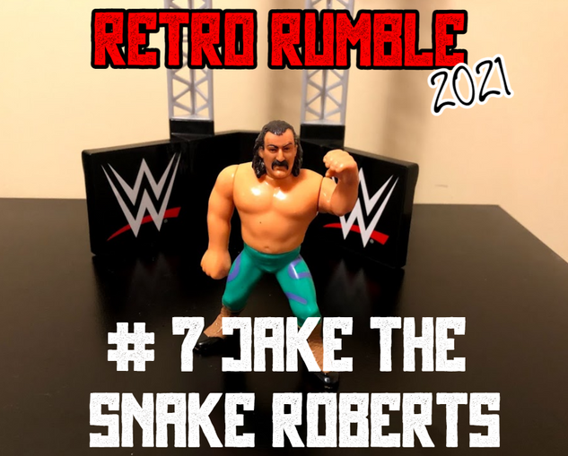 ... Jake The Snake Roberts! Will The Snake form an alliance with Hart and JYD? Will he turn on Lesnar? Will he attack Virgil, who is literally doing nothing but writhing around on the mat? Let's find out!