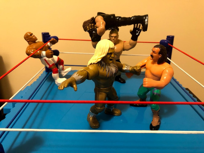 In the ring, Brock Lesnar is absolutely dominating the vigilante Sting, while Goldust and Jake The Snake Roberts are exchanging lefts and rights.