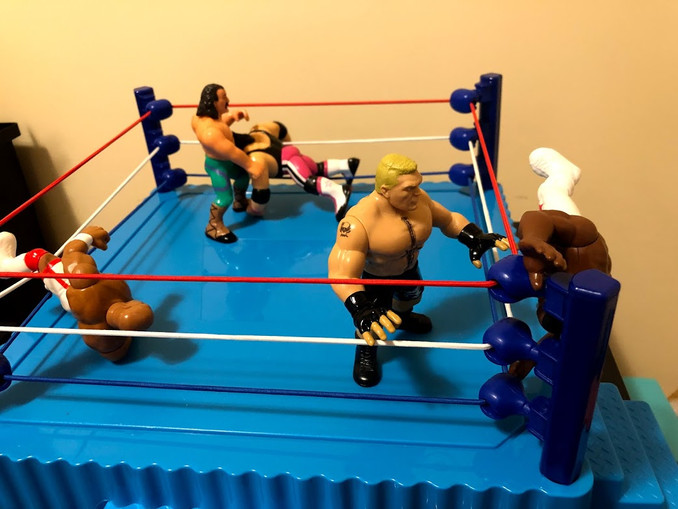 Roberts attacks Bret Hart and delivers a jarring DDT to the skull of The Hitman!  Meanwhile, on the other side of the ring, JYD can't match up with the power of Brock Lesnar, and he's been tossed out of the ring!