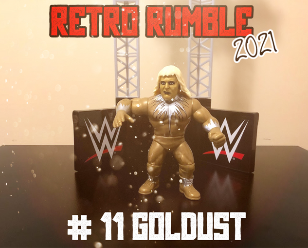 Here comes our next entrant..... it's the bizarre one, Goldust! Look at the gold flecks in the air - the art department at Wrestling Merchandise and Memories must have spent a pretty penny on that.