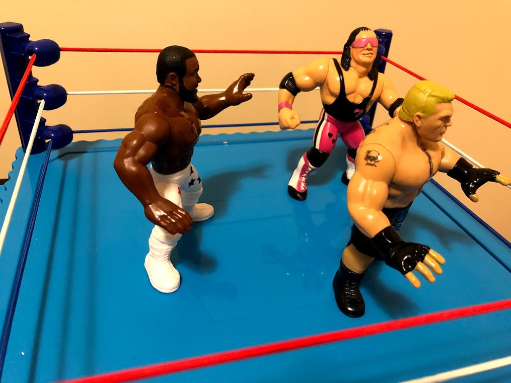 Immediately, Bret Hart and Junkyard Dog team up to take down The Beast Incarnate! While they haven't managed to eliminate Lesnar, they're at least keeping him at bay.  Oh, look at the time! Time for our next entry in three... two..... one.... Here comes....