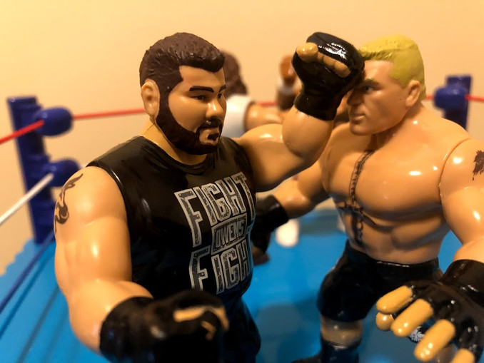 Kevin Owens has just punched Brock Lesnar right in the face. Ouch!