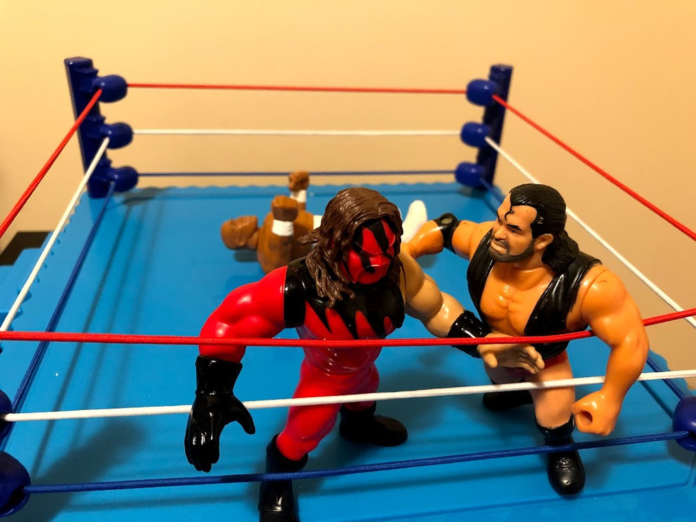 Razor Ramon and Kane are battling for leverage near the ropes.  Meanwhile, Virgil is slowly making his way to his feet...