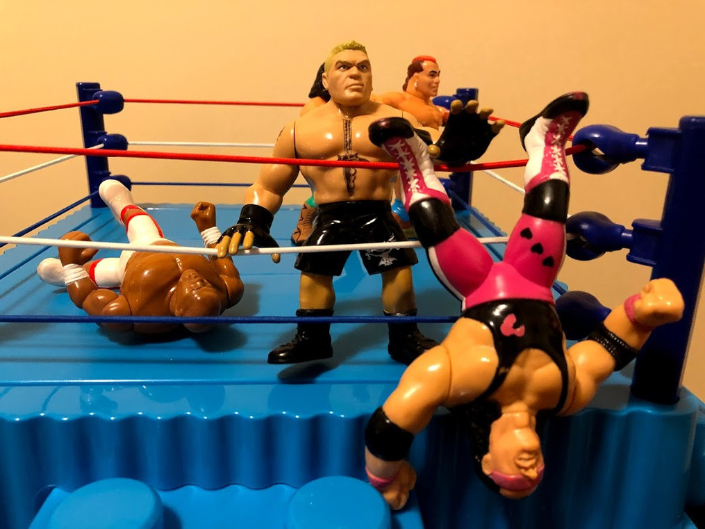 Lesnar delivers a German Suplex to Bret Hart picks him up and tosses him to the ground below for his second straight elimination!  Time for next entrant. Three... two.... one.... it's.....