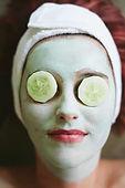 woman enjoying natural facial treatment