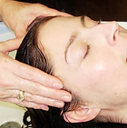 client receiving shiatsu scalp massage, provided with hair services