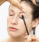 woman receiving application of nourishing make-up