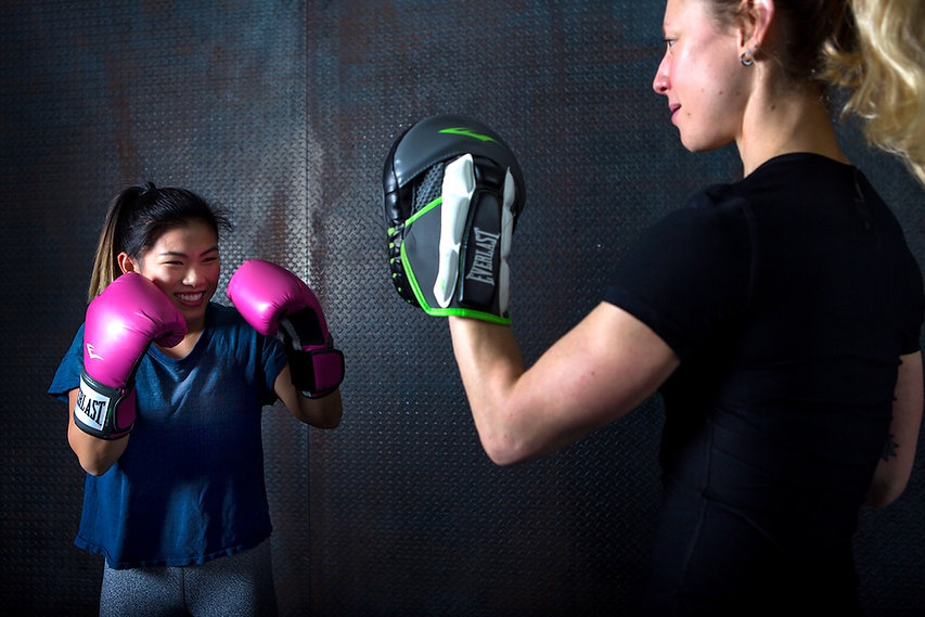 Wellness Blueprint - Woman boxing