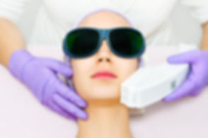 Young woman receiving laser treatment.jp