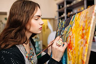 Creative painter paints a colorful pictu